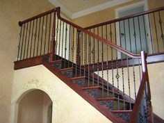 dark stairs, rail, with painted applique  Preferred Building Products > Product Gallery > Stair Parts