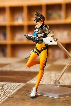 """Look out, world! figma Tracer's here.""From the globally popular multiplayer first-person shooter Overwatch® comes a figma of Tracer!  The smooth yet posable figma joints allow you to act out a variety of different scenes. A flexible plastic is used in specific areas, allowing proportions to be kept without compromising posability. Tracer comes with three face plates, including a smiling face, an excited expression, and a serious, confident expression. Optional parts..."