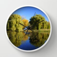 Reflection on the Lake Wall Clock by Claude Gariepy - $30.00