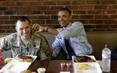 President Obama jokes with U.S. Army 1st Lt Bill Edwards as they eat at Kenny's BBQ in honor of the upcoming Father's Day weekend. Edwards is the 2012 Military Fatherhood Award Winner