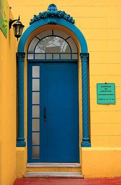Blue door on yellow