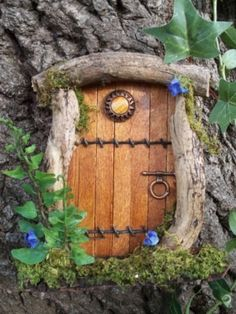 Fairy Door - looks like it's made of popsicle sticks, a button and a bracelet latch trimmed out in some branches. what fun