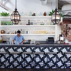 Black-and-white graphic tiles & stellar cocktails, it's no wonder we love this LA hot spot!