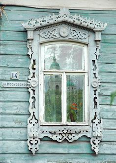 Decorative Russian Window Photography. Woodwork. Dacha, cabin. Ancient architecture. Light blue. Church reflection. Russia.