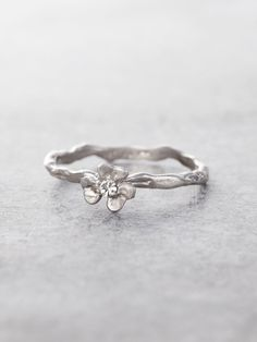 One of Nature's lucky blessings preserved in Sterling Silver, our beautifully handcrafted Clover ring features the enchanting kiss of a sparkling Diamond, a symbol of love and good fortune. Shown in S