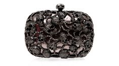 I love this....a jewel encrusted skull clutch!!!!