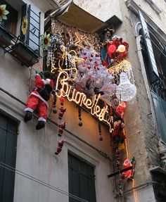 Christmas decorations on the window of a home in Venice, Italy - http://iamnotmakingthisup.net/8317/christmas-comes-to-venice/