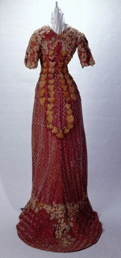 c1909 Women's lavender silk velvet princess line dress with short fitted sleeves, slightly flared skirt with train, and tan velvet leaves with purple highlights applied vertically down the front and back of the skirt.   http://collections.mohistory.org/resourceMgr/202643.html
