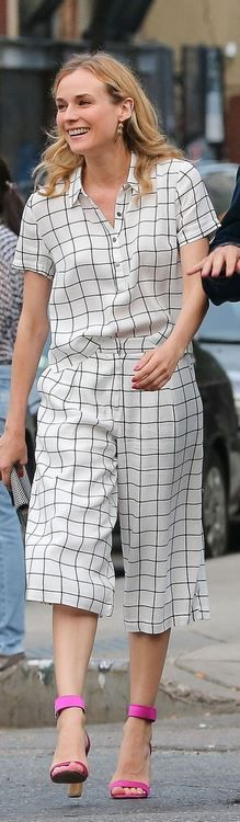 Who made Diane Kruger's white check pants, black plaid button shirt, and pink sandals?