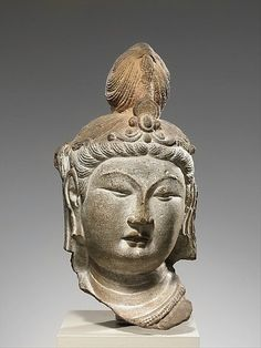ca, 770, Head of an attendant with elaborate headdress, likely a Bodhisattva, Tang dynasty Shrine Cave. Shaanxi Province, China.