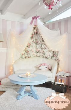 Pastel kawaii home inspo put in a nice chandelier, paint the coffee tables in a pastel, wainscoat the walls