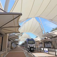 Light Rail Tensile Membrane Structures from FabriTec Structures Fabric Structure, Steel Structure, Light Rail Station, Membrane Structure, Tensile Structures, Temporary Structures, Canopy Design, Commercial Architecture, Facade