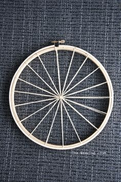 Weaving is a great way to create art and use all sorts of fibers and fabrics both new and recycled. This idea for creating a loom with an embroidery hoop and weaving in a spiral looks like a great … Weaving Textiles, Weaving Art, Weaving Patterns, Tapestry Weaving, Loom Weaving, Tshirt Garn, Circular Weaving, Circle Loom, Round Loom