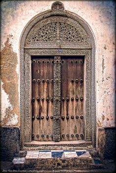 Stone Town, Zanzibar, Tanzania, Africa Ancient vintage door with pointy metal decorations (to stop the elephants from forcing them down!) and hand carvings Portal, Entrance Doors, Doorway, Old Doors, Windows And Doors, Doors Of Stone, Africa Nature, Stone Town, Knobs And Knockers