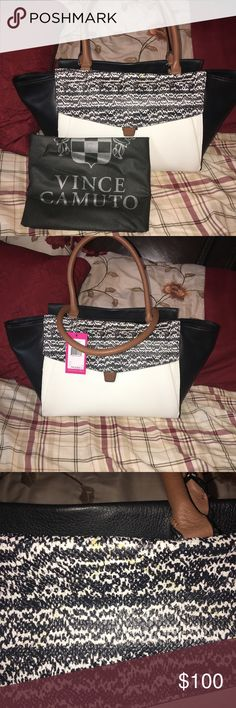 New Vince Camuto lonni satchel with dust bag! Comes from a smoke free home! Brand new with tags! Has a little bit of a stain as shown in the picture! Comes with the dust bag as well! Vince Camuto Bags Satchels