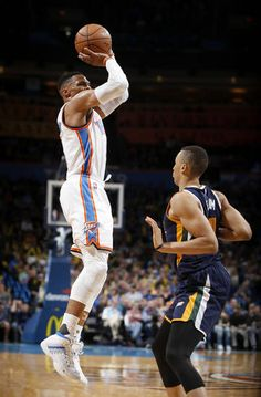 Oklahoma City's Russell Westbrook (0) is fouled as he shoots over Utah's Dante Exum (11) during an NBA basketball game between the Oklahoma City Thunder and the Utah Jazz at Chesapeake Energy Arena in Oklahoma City, Tuesday, Feb. 28, 2017. Photo by Bryan Terry, The Oklahoman