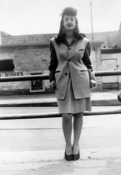 You've heard of zoot suits - but did you know there were also zoot skirt suits? A woman only identified by her first name, Josie, is wearing one such suit while standing on the corner of E. 41st St. and Long Beach Avenue in Los Angeles, California in 1945. In the background is the restaurant, El Tonga.