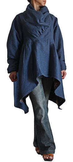 Volume. Blue linen blouse.