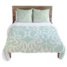 Refresh your master suite or guest room with this lovely duvet cover, showcasing a scrolling motif for eye-catching appeal.   Product: