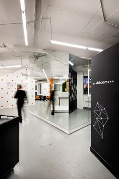 An open-plan office full of offbeat, house-like pods for different work zones.