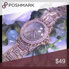 """GOLD STAINLESS STEEL RHINESTONE QUARTZ WATCH FAUX GOLD STAINLESS STEEL RHINESTONE QUARTZ WATCH. 9"""" BUT LINKS CAN BE EASILY TAKEN OUT TO MAKE SMALLER. NEW IN BAG. GORGEOUS SHINE! THE RHINESTONES HAVE CLEAR WRAPPING ON THEM IN THE FIRST PICTURE TO PROTECT THE WATCH UNTIL YOU GET IT. boutique Jewelry"""