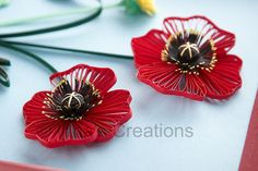 Quilled poppy flowers, close-up