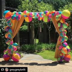 #Repost @greygreybritt Welcome your guests with a beach ball arch! How fun and…