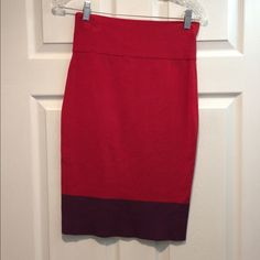 Express High Waisted Skirt This skirt is red with a purple trim at the bottom. It is entirely stretch material and is meant to hit high at the waist and low around the knee. Looks adorable paired with a crop top. Express Skirts Pencil