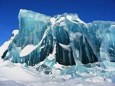 Antarctica frozen blue sea ice.