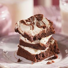 Fudgy Cream-Cheese Brownies:  Using less than half the sugar of traditional brownie recipes, these tasty treats sneak in 1/4 cup of calorie-free sweetener. Reduced-calorie margarine and low-fat dairy products knock off an additional 15 grams of fat. If you're serving these at a festive occasion, add a few drops of red food coloring to the cream-cheese mixture! | Health.com