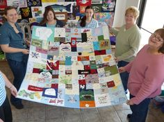 keepsake baby clothes quilt, I love how they did the socks and hospital shirt