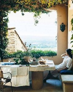 Stone table, food and an awesome view.