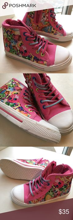 Shopkins High Top Fashion Sneakers Zip-Up NWOT Shopkins High Tops w/zipper. These bright and fun shoes have never been worn. There are gray marks on the front rubber of the left shoe and a gray mark on the side of the right shoe...These small marks were present from either manufacturing, shipping or retail handling not entirely sure. Moose Shoes Sneakers