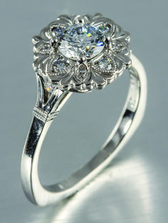Scallop Halo Engagement ring with milgrain details!