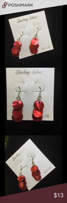 Sterling Silver Earrings !  Sterling silver earrings from Kohls ! For pierced ears ! About 1 1/2 inches in length ! Dangling reddish circles ! Very pretty !  Jewelry Earrings