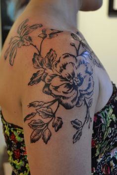 See more Shinning black flower design tattoo on shoulder and arms