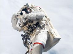 STS-123 mission specialist Rick Linnehan takes a picture during the mission's third spacewalk in 2008.