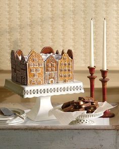 Gingerbread Town-Square Cake Recipe - Dacquoise is a cake made of meringue layers (usually nut flavored) and buttercream or whipped-cream filling. This version consists of walnut meringue, gingerbread-spiced buttercream, and spongy cake layers and is covered with a generous amount of fluffy white frosting.