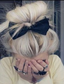 A cute black bow will stand out in your light blonde hair.