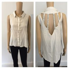 Large ivory Hilo top cutout back Loose fit ivory hi lo collared top with caged cutout back with rhinestone detail  New without tags, however each shirt is individually wrapped in plastic.  Color: ivory.           NO TRADES!!!! Tops Button Down Shirts