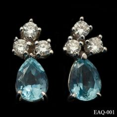 Aquamarine and diamond earrings in 18ct white gold. The pretty pale blue teardrop aquamarines are complimented by three round cut diamonds. £795