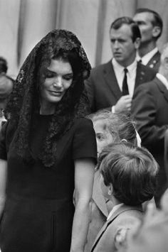 Jacqueline Kennedy holds her son's hand as they exit St. Patrick's Cathedral in New York, following the funeral of his uncle and her brother-in-law Senator Robert F. Kennedy.