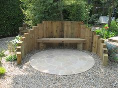 timber sleepers to create a fire pit and seating area, complete with Indian Sandstone circle kit and gravel garden surround.Raised timber sleepers to create a fire pit and seating area, complete with Indian Sandstone circle kit and gravel garden surround. Fire Pit Seating, Backyard Seating, Fire Pit Backyard, Outdoor Seating, Backyard Landscaping, Seating Area In Garden, Backyard Ideas, Firepit Ideas, Outdoor Rooms