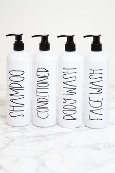It's so easy to organize your bathroom with these modern farmhouse shampoo bottles. Each bottle is custom labeled for you and comes with a pump. The refillable shampoo and conditioner bottles hold 16 oz each. Modern Farmhouse Bathroom Decor - Bathroom Organization - Modern Bathrooms - Bathroom Remodel - Bathroom Shower Storage Containers - Refillable Shampoo and Conditioner Bottles White Personalized Wine, Personalized Christmas Gifts, Shampoo Dispenser, Shampoo Bottles, Wine Mom, Waterproof Labels, Mother's Day Photos, Tumblers With Lids, Bottle Labels