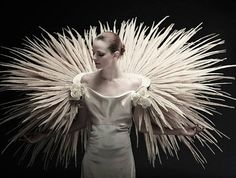 Many of Jess's unusual pieces are bridal wear, including this dramatic gown with a feather shoulder piece