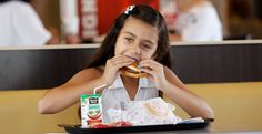 Paolo Beldran eats a healthy choice meal at a south Miami Burger King Tuesday, July 12, 2011. - ASSOCIATED PRESS