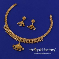 Small chhela half-spheres formally arranged to form an apron front and a swinging wire-ball pendant give this necklace a clean, ordered character with a nicely-turned-out traditional look. With matched earrings, a lightweight set handmade in hallmarked 22K gold. #handmadegoldjewellery