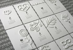very cool calendar - love the white on white with diecuts
