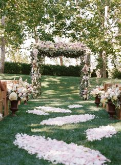 Floral Wedding Arbor and Rose Petal Aisle   photography by http://carrie-patterson.squarespace.com/