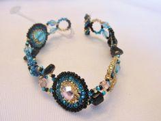 Shared Treasures Boutique - Guatemalan Beaded Bracelet - Geometric pattern -  Blue / Gold, $20.00 (http://www.sharedtreasuresboutique.com/guatemalan-beaded-bracelet-geometric-pattern-blue-gold/)